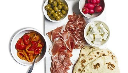 Antipasti platter with homemade flatbreads